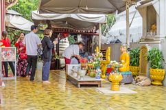 Devout buddhists practicing their rituals in the Wat Phnom in Ph. Phnom Penh, Cambodia - April 8, 2018: Devout buddhists practicing their rituals in the Pagoda stock photography