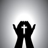 Devout christian worshiping with cross in hand Stock Photos