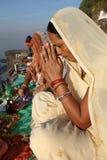 Devout Hindu pilgrim in Maheshwar, India. Devout Hindu pilgrim prays on the ghats of the sacred river Narmada in Maheshwar, India royalty free stock images