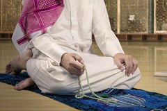 Devout muslim man dhikr in the mosque Stock Image