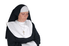 Devout nun. Middle aged devout nun in deep thoughts, praying Stock Image