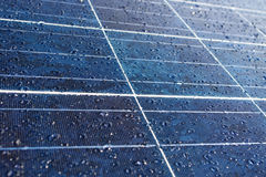 Dew or rain drops on solar panel Stock Images
