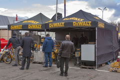 DeWalt American company outdoor booth. Visitors visit DeWalt American company founded 1936 outdoor booth during 3rd International forum of building materials and Royalty Free Stock Image