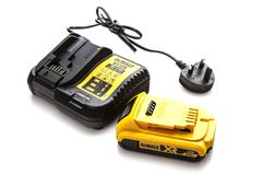 DeWalt DCB113 cordless power tool battery charger and battery on a white background Stock Photos