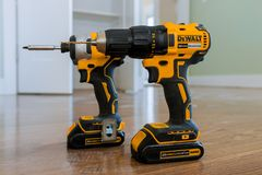 Free DeWalt Is An American Worldwide Brand Of Power Tools And Hand Tools A Wooden Floor Of New House For The Construction Stock Images - 164827464