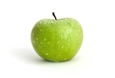 Dewed apple. Green apple with waterdrops against white background stock photography