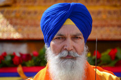 Dewotka sikhijczyk z błękitnym turbanem obrazy royalty free