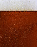 Dewy Black beer glass texture. W froth Stock Photo