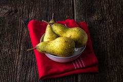 dewy fresh pears in a bowl Stock Photo