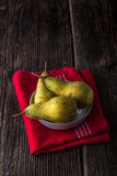 dewy fresh pears in a bowl Stock Images