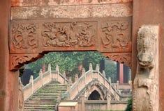 Deyang, China: Deyang Confucian Temple. View through the 1851 Lingxing Archway Gate to the serene Pan Bridge with its lion balustrades at the historic Deyang Royalty Free Stock Photos