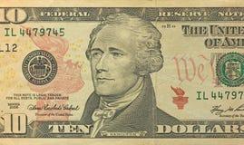 Dez dólares com uma nota 10 dólares Foto de Stock Royalty Free