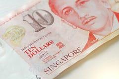 Dez dólares de Cingapura com uma nota 10 dólares Foto de Stock Royalty Free