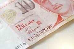 Dez dólares de Cingapura com uma nota 10 dólares Fotos de Stock Royalty Free