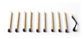 Dez fósforos, último são queimados para fora Foto de Stock Royalty Free