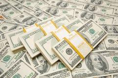 Dez mil pilhas do dólar Fotos de Stock Royalty Free
