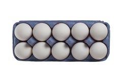 Dez ovos no pacote isolado no branco Fotografia de Stock Royalty Free