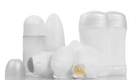 Dezodoranty i storczykowy kwiat fotografia stock