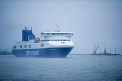 DFDS SEAWAYS ship OPTIMA in Klaipeda harbor. KLAIPEDA, LITHUANIA - MAY 31: DFDS SEAWAYS ship OPTIMA in Klaipeda harbor on May 31, 2014 Klaipeda, Lithuania. DFDS royalty free stock image