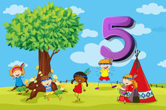 DFlashcard number 5 with five children in the park Stock Image