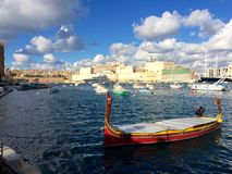 Dghajsa boat. Traditional dghajsa boat in Birgu, Malta Royalty Free Stock Photo