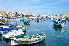 Dghajsa boats in Marsaxlokk harbour, Malta. Royalty Free Stock Photography