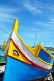 Dghajsa on the quayside, Marsaxlokk. Stock Image