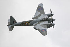DH98 Mosquito fighter bomber. De Havilland DH98 Mosquito fighter bomber in Royal Air Force RAF markings and camouflage making a fly past during an airshow Royalty Free Stock Images