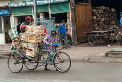 DHAKA, BANGLADESH – JANUARY 26, 2008 : Cycle rickshaw puller ... stock image