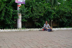 Dhaka, bangladesh, august 2017-a blind street beggar sitting on foothpath located at bonani resudential area in dhaka in Royalty Free Stock Image
