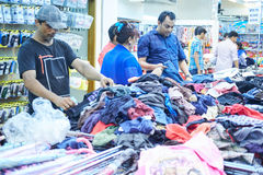 Dhaka, bangladesh, august 2017- poeple are shopping cloths and shoes at local cheap shopping center ocated at. Dhaka, bangladesh, august 2017- poeple are Royalty Free Stock Image