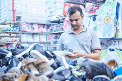 Dhaka, bangladesh, august 2017- poeple are shopping cloths and shoes at local cheap shopping center ocated at. Dhaka, bangladesh, august 2017- poeple are Stock Photos