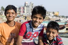 Dhaka, Bangladesh, February 24 2017: Three teenagers posing proudly. And laughing in Dhaka Bangladesh in front of the camera stock photo