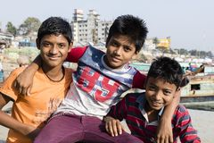 Dhaka, Bangladesh, February 24 2017: Three teenagers posing proudly. And laughing in Dhaka Bangladesh in front of the camera royalty free stock images