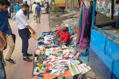 Dhaka bangladesh 1 march 2018. unrecognized man selling cloths and other iteams on foot path located at shantinogor in. Dhaka in bangladesh Stock Images