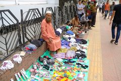 Dhaka bangladesh 1 march 2018. unrecognized man selling cloths and other iteams on foot path located at shantinogor in. Dhaka in bangladesh Stock Photos