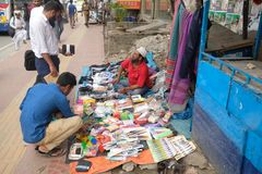 Dhaka bangladesh 1 march 2018. unrecognized man selling cloths and other iteams on foot path located at shantinogor in. Dhaka in bangladesh Royalty Free Stock Image