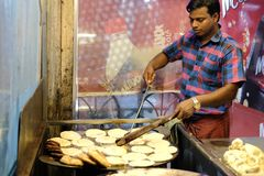 Dhaka, bangladesh, september 17, bangladesh chef cooking street junk food at street located at mogbazar area in dhaka in Royalty Free Stock Photography