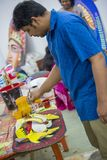 Art institute student painting a colorful mask. Dhaka, Bangladesh. 12th Apr, 2016. Dhaka University Fine Arts FFA student paints a mural to celebrate upcoming stock images