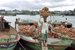 Dhaka cityscape with workers, slum,river and boats Stock Photo