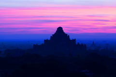 Dhammayangyi pagoda at sunset in Bagan Archaeological zone, Myanmar Royalty Free Stock Photos