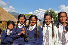 DHAMPUS, NEPAL - JANUARY 9, 2015: School girls  with Himalaya mountains in the background near Pokhara Royalty Free Stock Images