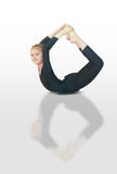 Dhanurasana yoga. Little girl doing yoga on white background Royalty Free Stock Image