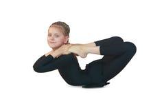 Dhanurasana yoga. Little girl doing yoga on white background Stock Image