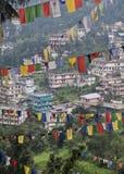 Dharamsala, India, Mcleod Ganj. India, Dharamsala, Mcleod Ganj through Tibetan Buddhist Prayer Flags Royalty Free Stock Photos
