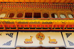 A Dharma-cakra between two kneeling goats. In Norbulingka, Lhasa, Tibet stock photography