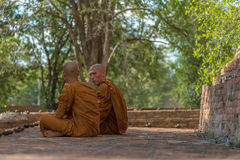 Dharma Talk. A senior monk is mentoring the Dharma practice to a new ordained monk. Guidance correctly is the key to achieving the teachings of the Buddha Stock Image