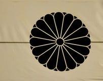 Dharma Wheel Buddhist symbol on flag. At temple in Nagano, Japan royalty free stock image