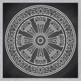 Dharma Wheel, Dharmachakra. Symbol of Buddha`s teachings on the path to enlightenment, liberation from the karmic. Rebirth in samsara. Tattoo design. Chalk on a Royalty Free Stock Photos