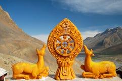 Dharma wheel Stock Images